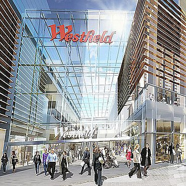 A print of the glass entry and visitors to the Westfield Stratford City shopping centre in England.