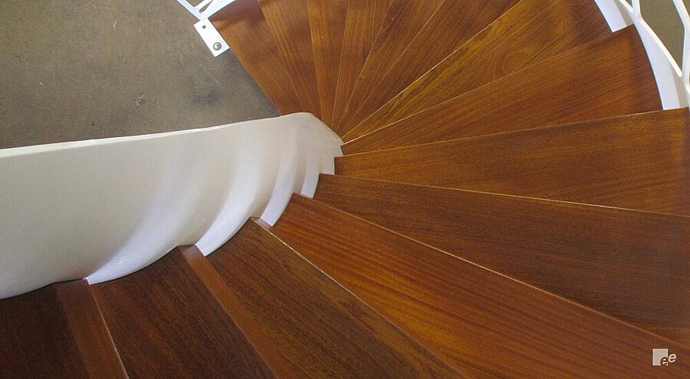 A narrow, winding staircase with oaken treads, designed by architect Mark Cutone and installed in front of a summer residence.