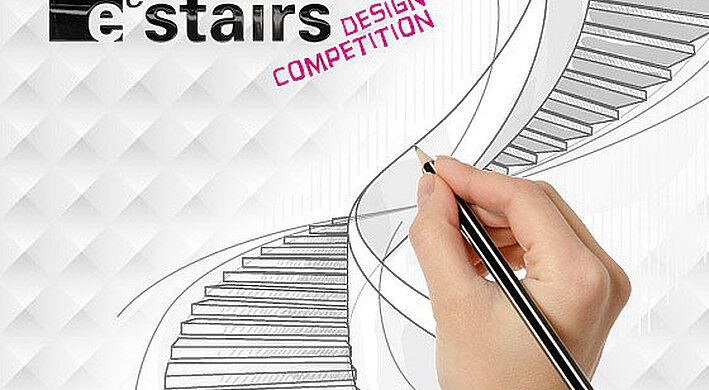 A hand sketches with a pencil sketches a winding staircase on a checked surface with black and pink letters on it.