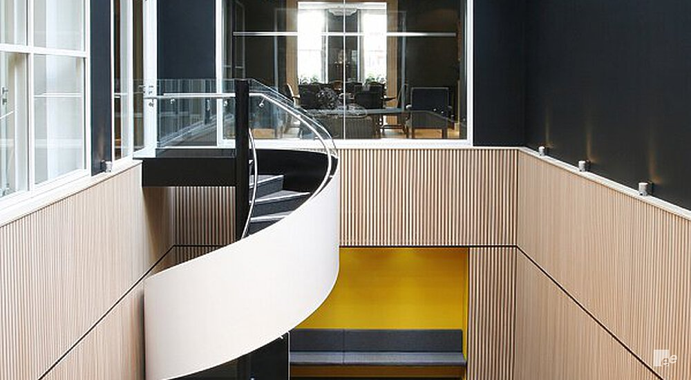 Wooden walls, a winding staircase and window frames in the law offices of Brown Rudnick's Mayfair in London.