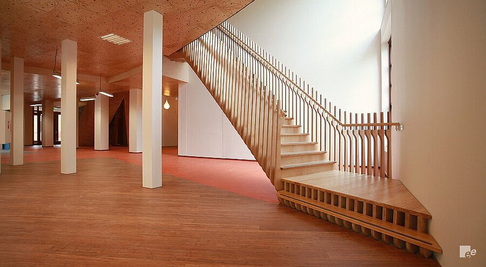 A Bamboo Staircase With Landings, In A Room With Parquet Floor, Pillars And  A