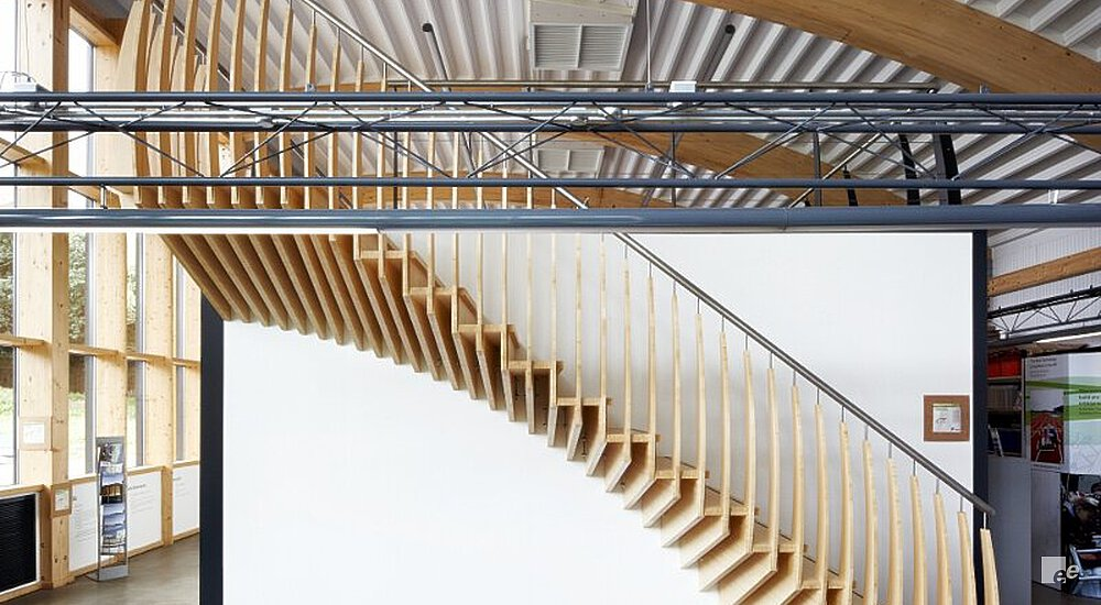 A Bamboo Staircase In A Property With Wooden Rafters And A Curved  Corrugated Roof With Air ...