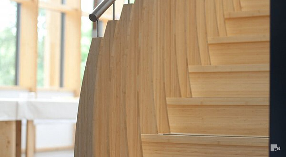 A Close Up Of A Bamboo Staircase With Stainless Steel Handrail. The Windows  With