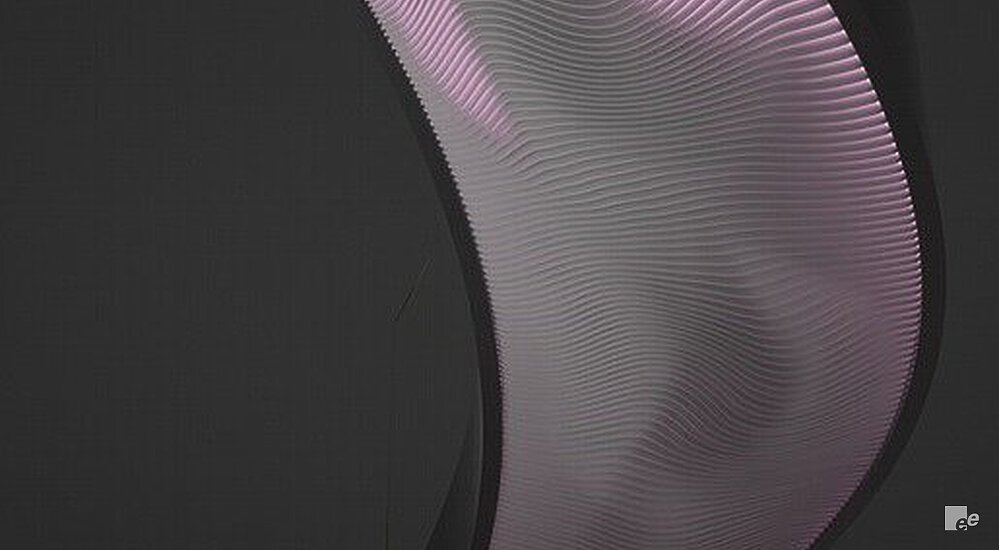 A dark environment in which it appears as though the EeSoffit material of a winding staircase emits a light purple glow.