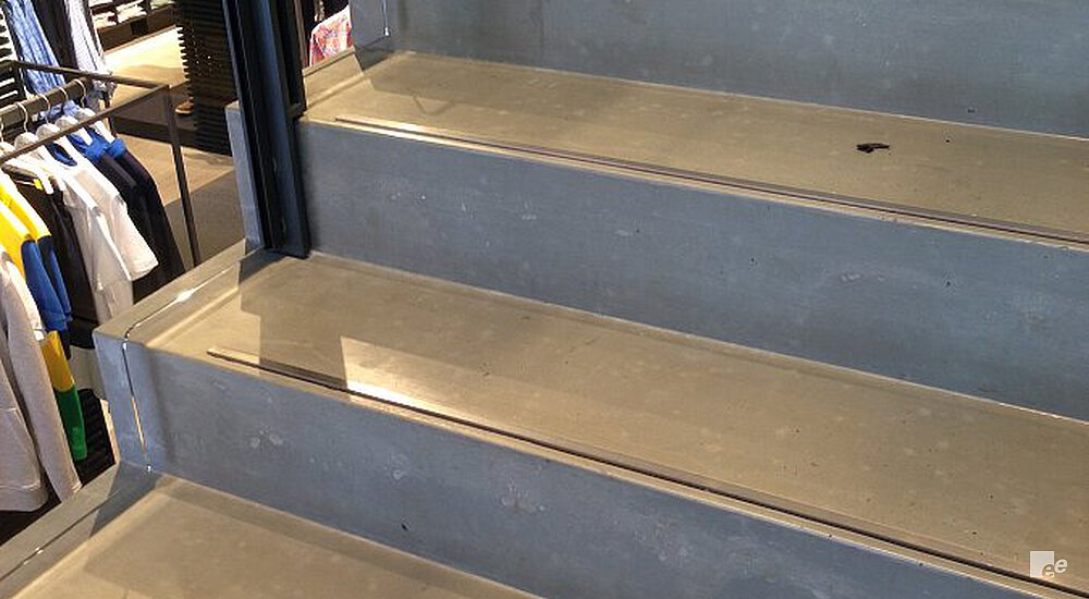 The concrete treads of the staircase in the shop of Lacoste in Regent Street in London.