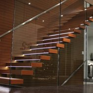 A floating staircase with multiplex treads with veneer in a residence in St Catharines in Ontario.