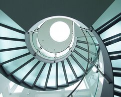 The underside view of a glass winding staircase, in a residence in Orwigsburg in the United States.