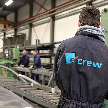 EeStairs employees at work in overalls at the workshop.
