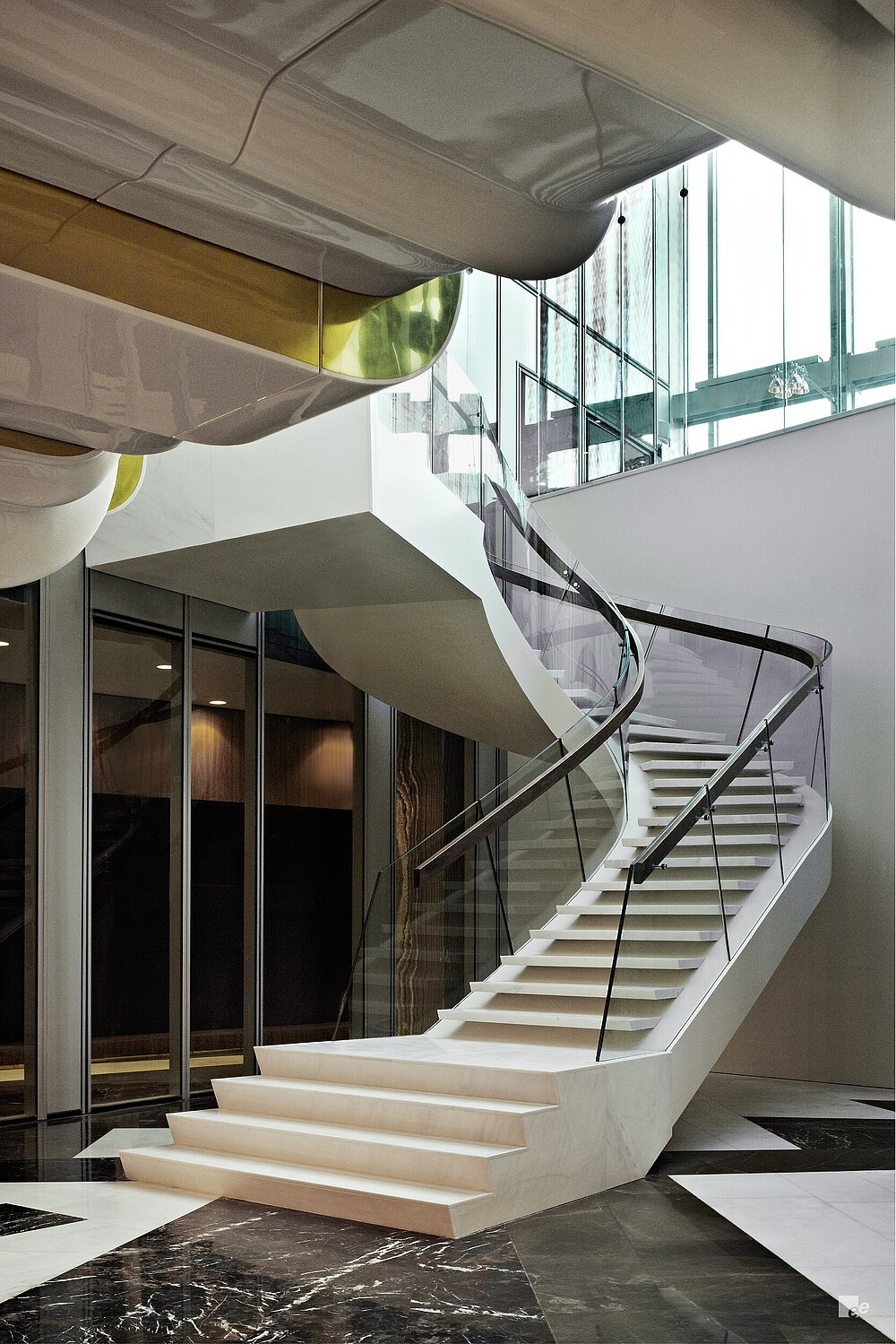 glass is also used in the staircases rounded design contrasting with straight shapes and sharp angles throughout the rest of the buildings interior - Blackstone Home Design